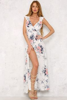 The Desert Flower Maxi Dress has thicker shoulder straps, with a self-tie front and a gorgeous print. Wear with simple white sandals and peach nails! Maxi dress. Partly lined. Cold hand wash only. Model is standard XS and is wearing XS. True to size. Non stretchy fabric. Cotton/polyester.