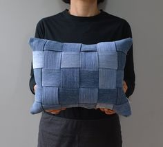 Varying shades of denim and the sleek, modern texture of wide, woven slats create an eye-catching pillow. Upcycling at its finest! Imagine it in a cabin or city apartment or anywhere in between....denim is universal! The edges of the slats are sewn to prevent fraying, and as a whole theyre sewn to a top layer of solid denim. These two layers are backed by another piece of denim and its stuffed with new polyester fiberfill. The pillow is sewn all the way around and is best spot or dry…