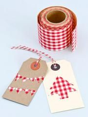 Single roll of adhesive-backed red checked fabric tape. This roll of tape is wide, at 45mm, but not long - only 1 metre, but we made the tags below with...