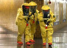 individuals in hazmat suits on Boston T