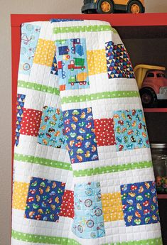 You've wanted to make an easy baby quilt. You're in the market for super simple patchwork. Quiltmaker's Block by Block digital quilt pattern by Heidi Pridemore is perfect for your next quilting project! Its simple lines and g Baby Boy Quilt Patterns, Baby Boy Quilts, Kid Quilts, Amish Quilts, Scrappy Quilts, Easy Quilts, Small Quilts, Bright Quilts, Quilt Kits
