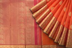 Handwoven Orange Kanakavalli Kanjivaram Saree with self design and buttas all over the body. The saree has big zari border with elephants and red pallu.