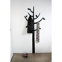 Apply decal or paint a tree + install hooks = instant coat or towel rack