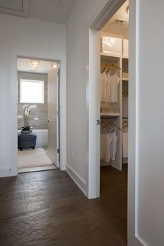 Just outside of the master bedroom door is a small hallway that leads to both the master bathroom and a fabulous master closet.