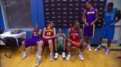 Celtics rookie Fab Melo runs into trouble with a folding chair at the Rookie Photo Shoot.