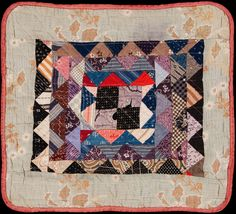 """DOLL QUILT    BY HATTIE AREHART Circa 1916 14"""" x 13"""" Hattie was a neighbor of my great grandmother, Anna Hoover Weaver. This quilt was saved by my aunt, Agnes Weaver Eigsti, (1910-2010) who thought that Anna, her grandmother, might have helped make it. Anna Hoover Weaver's husband's barn still says J Weaver 1889 in the roof tiles and can be seen along County Road 34 near Goshen, Indiana."""