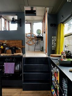 Homes: Paris Boat: Interior of houseboat showing part of the kitchen