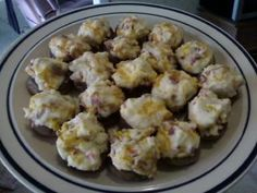 Cream Cheese & Bacon Stuffed Mushrooms. This picture does not do it justice! When I make these I have the hardest time not eating them all before someone else can get their fingers on them. The secret with any stuffed mushroom is to bake with lots of butter in the pan...so yummy!
