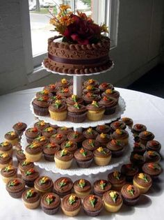 chocolate wedding cake tower from cupcakes with unique topper