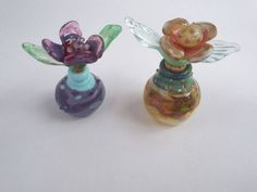 Check out this item in my Etsy shop https://www.etsy.com/uk/listing/479473411/hand-blown-miniature-perfume-bottles-by