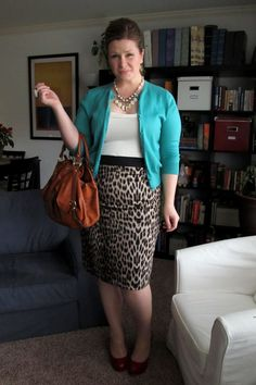oh! I love the pretty blue cardigan with the animal print skirt! love it!