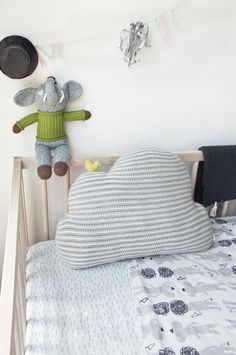 The soft hues and playful design of this pillow makes for the perfect combination. We love the way this looks on a nursery rocker. Dimensions & Details: - 100% cotton - 18 X 13 X 4 inches
