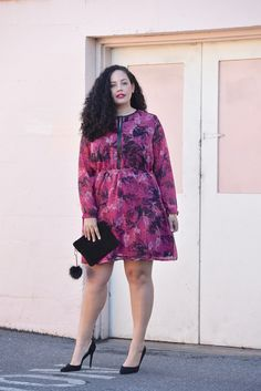 Girl With Curves blogger Tanesha Awasthi wears a long sleeve floral print mini dress.