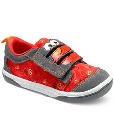 Get him smiling from cheek to cheek when he straps on these awesome Elmo sneakers from Stride Rite! He'll love the Sesame Street character's allover design and a comfy hook-and-loop closure. | Suede u