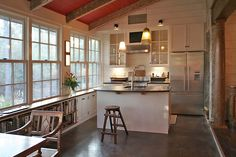 Love the shallow cabinets & counters running under the windows - Spring Island Cottage by BRZ Architecture 9