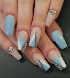 This sophisticated but very soothing nail art design is made up of blue, white and silver glitter triangular tips. Adding some diamonds creates a more dazzling look.