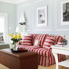 Out to Sea     For a nautical theme, combine cool gray walls, white trim, and red stripes. Here, the red striped couch pops against the crisp paint and serves as an anchor for this space. Framed photos and accessories reminiscent of sailing days complete the theme, while white trim adds architectural interest  Don't like the brown trunk though!