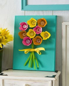 An adorable spring bouquet using egg cartons, pipe wire, ribbon and buttons or caps!