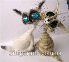 Oh my goodness!  These crochet kitties are adorable.  A little creepy, but still adorable.  :)
