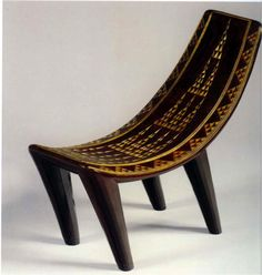 Pierre Legrain, Stool. Lacquered Wood, horn and gold. French, 1923. -decorative pegs -designer translates a primitive design into luxury usi...