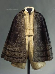 Man's Cape. Bridegroom's cape of Duke Johann Georg (I.) of Saxony used at his weddings with Sibylla Elisabeth of Württemberg in 1604 at Dresden, and with Magdalena Sibylla of Brandenburg-Prussia in 1607 at Torgau. Textile: Italy or Spain. Embroidery: German, probably Saxony. Inv. I 14. Underneath jacket and pants, made for the same occasions, probably Saxony. Inv. I 15. Photo: Hans-Peter Klut.  Location:  Ruestkammer, Staatliche Kunstsammlungen, Dresden, Germany