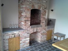 Fire place, oak wood cabinet doors. Natural stone tablet and old style water tab.