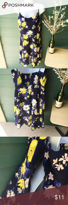 NWOT Floral Sun Dress This is a gorgeous dress that I unfortunately never had the opportunity to wear because the first time I went to try it on, the **zipper got stuck**. So it has been sitting in my closet untouched. I tried once to fix the zipper, but am no expert so just left it to Posh in hopes that someone who is good with fixing clothes can enjoy this. Size XL, true to size. No other flaws or damages, like new other than zipper. Price reflects zipper defect. Old Navy Dresses Midi