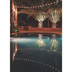 Hang string lights directly above the pool for a cool mirrored effect at night. Shop all lengths, colors and sizes online at www.partylights.com.