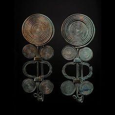 European Bronze Age pair of bronze spiral fibulas, 1st millenium B.C. 23 cm long. Private collection