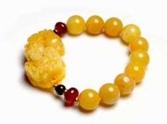 Yellow Honey Jade Fortune Pi Shou Tiger Amulet Bracelet-Yellow Jade Gemstone Bracelet size: stretch adjustable cord min 16cm -Made from Genuine Yellow Jade 13mm beads and Pi-Shou symbol( 43mm x 25mm x 8mm) 2 carnelian decorative beads, 2 black agate beads, -free for all customers , special offer Imperial golden dragon wrapping and fortune feng shui envelope - handmade designer's jewelry