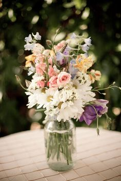 This is what I want for my bouquets and then a smaller version for the centerpieces. I just love this look.