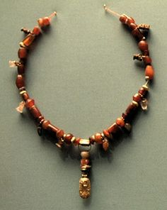 Assyrian jewellery was not simply pretty adorment. Coloured stones (and glass) were considered to have beneficial properties: they warded off evil and protected against harm. Healers often prescribed protective necklaces to be worn during times of illness or stress. BM ANE 127228, photo by Eleanor Robson.