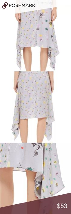 TOPSHOP Boutique Mix Floral Skirt Front of skirt has two complimenting floral prints. Sides drape down above the ankle. Side has hidden zipper. 100% Viscose. Dry clean. Topshop Skirts Asymmetrical