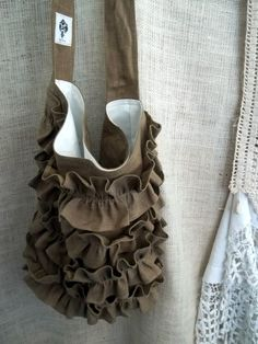 Ruffle tote, I ended up making an entire ruffle diaper bag that closes with elastic side pockets. This was a fun inspiration for a completely different bag. :)