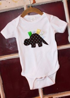Items similar to Dinosaur Applique Onesie on Etsy Sewing For Kids, Baby Sewing, Boy Onesie, Onesies, Quilting Projects, Sewing Projects, Applique Onesie, Going Home Outfit, Kids Logo