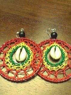 Crocheted earrings in a spiral shape. Rasta Tattoo, Dread Wraps, Rasta Colors, Spiral Shape, Yarn Projects, Ear Rings, Reggae, Red Gold, Wearable Art