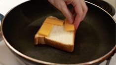 Hand adding slices of cheddar cheese to a slice of white bread in a skillet. Perfect Grilled Cheese, Different Types Of Bread, Homemade White Bread, Grill Cheese Sandwich Recipes, Sweet Cornbread, Slice Of Bread, Melted Cheese, Cheddar Cheese, Sandwiches