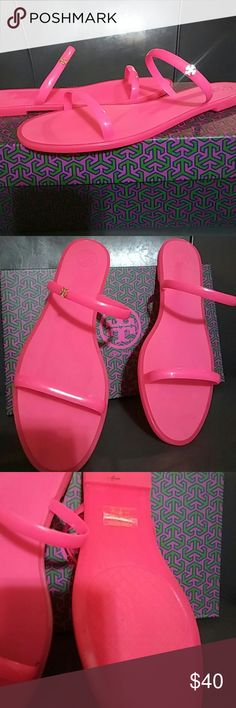 Pink Tory Burch sandals Fluo pink two- band jelly slide- shiny sandals. With gold Tory Burch logo on the band of the sandal as seen in the pic.. Box comes with Tory Burch Shoes Sandals