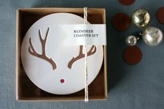 Letterpress Reindeer Coaster Set by gingertreepress on Etsy... try this wit the sharpie... 350 degrees for 30 min