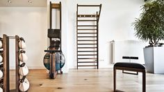 Browse images of minimalistic Gym designs: WaterRower Walnut Home Gym and Fitness Equipment. Find the best photos for ideas & inspiration to create your perfect home.