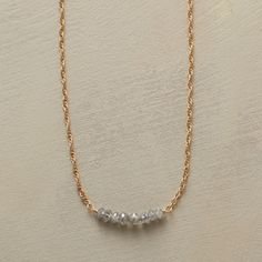 "DIAMOND DELICATO NECKLACE -- Teensy, twisted links of 14kt gold complement eight delicate, raw diamonds, each a beautiful contradiction of sparkle and opacity. Handcrafted in USA by Julie Lynn Romanenko. Spring ring clasp. 16""L."