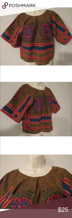 """Womens African Dashiki Shirt Blouse Size Small 🌹 Womens African Dashiki Shirt Blouse Size Small, This Very Beautiful Afrocentric Top Is Handmade And Has Never Been Worn, Excellent Condition, Back Side Is The Same As The Front Clean And Ready To Wear From A Smoke Free Home!   Measures 21 1/2"""" From Shoulder To Bottom Of Shirt   Any Questions? Feel Free To Ask! Also Check Out My Other Items As Well! Thank You! 🌹 Tops Blouses"""