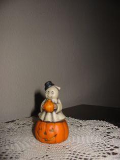 $3 Tiny Ghost holding a pumpkin sitting on a pumpkin. #cat #ceramic #Decor