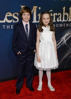 Les Mis (2012) | New York Premiere: Daniel Huttlestone (Gavroche) and Isabelle Allen (young Cosette) on the Les Miserables Red Carpet at the Ziegfeld Theater, Dec. 10, 2012.