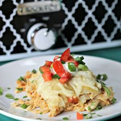 Looking for a delicious Mexican recipe? Try this super easy Crock pot Chicken Enchilada casserole. Your favorite enchilada recipe cooked in a crock pot!