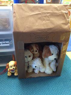 PreK pet/vet unit: cardboard box dog house full of stuff puppies