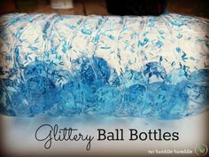Glittery Ball Bottles: a simple, inexpensive activity for preschoolers. This craft is so much fun, and watching the clear balls bounce with glitter is fun and soothing!