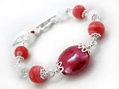 Ginger Sweets bracelet $15.00 - Ladies beaded Jade and Rhodonite bracelet. Murano glass, pink Rhodonite, white Jade, and Tibet silver onto silver plated wire.