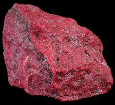Cinnabar is the chief mineral composed of the element mercury, and is a very important ore mineral. Though most Cinnabar is massive and uninteresting in habit, several localities produce phenomenal and strikingly colored red crystals that stand out with beautiful contrast on top of a white matrix.