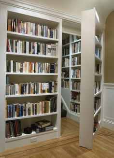A secret staircase and room full of books hidden by...a bookshelf.